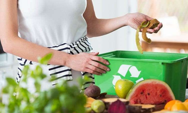 Woman Throwing Food Waste
