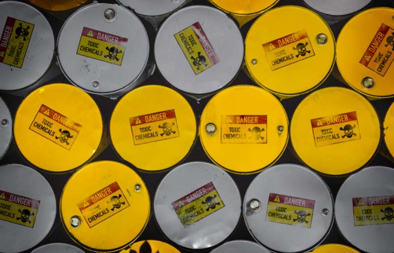 """Eco-friendly paint - free image from canva of metal barrels labelled """"toxic chemicals'"""
