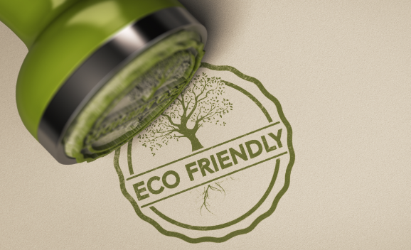 """Sustainability certifications - free image from canva of a stamp and the stamped words """"eco-friendly"""" in green ink."""