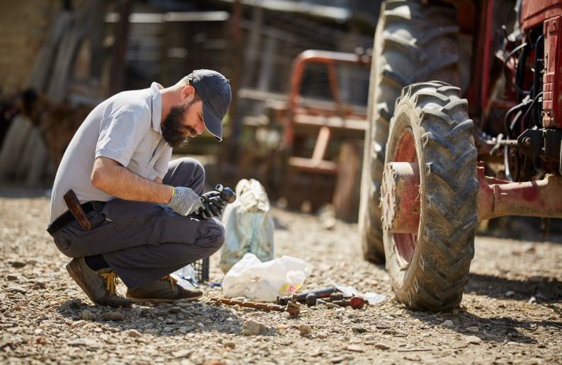 Living off the grid - free image from canva of a man fixing machinery on a farm