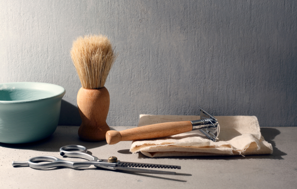 Eco Swaps - Safety Razor, wooden shaving brush and metal scissors - Image from Canva