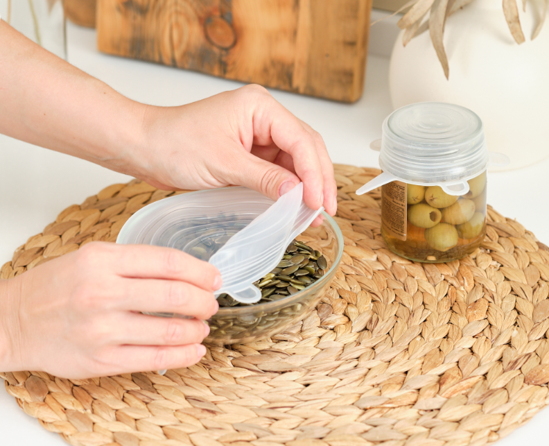Eco Swaps - Image from Cava of Silicone Food Covers on a bottle of olives and a bowl of seeds