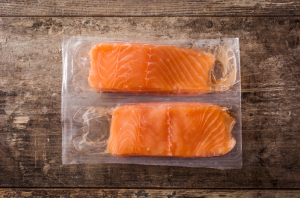 wild-caught fish - stock image from Canva of two vacuum packed salmon fillets on a wood board