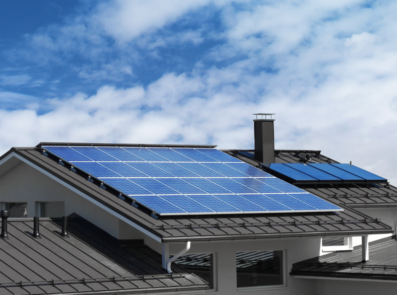 self-sufficient homes: image of solar panels on a residential building roof