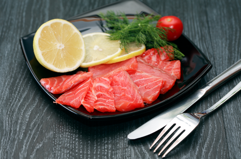 wild-caught fish - stock image from Canva of salmon fillets on a plate with lemon