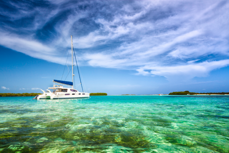 Solar Boats - Stock image of a yacht on blue water