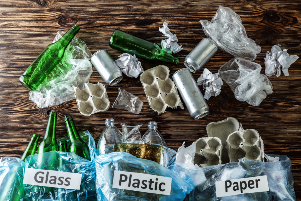 Teaching kids about sustainability - sorting recycling into glass, paper, and plastic