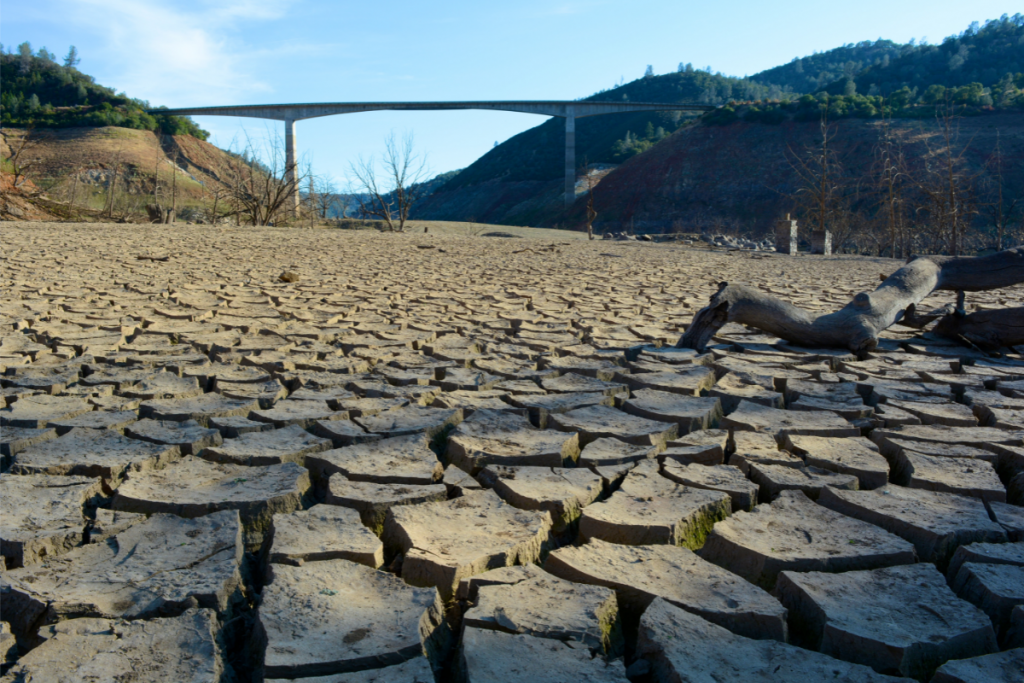 Ways to Conserve Water - Californa Drought - Dry River Bed Under New Melones Bridge