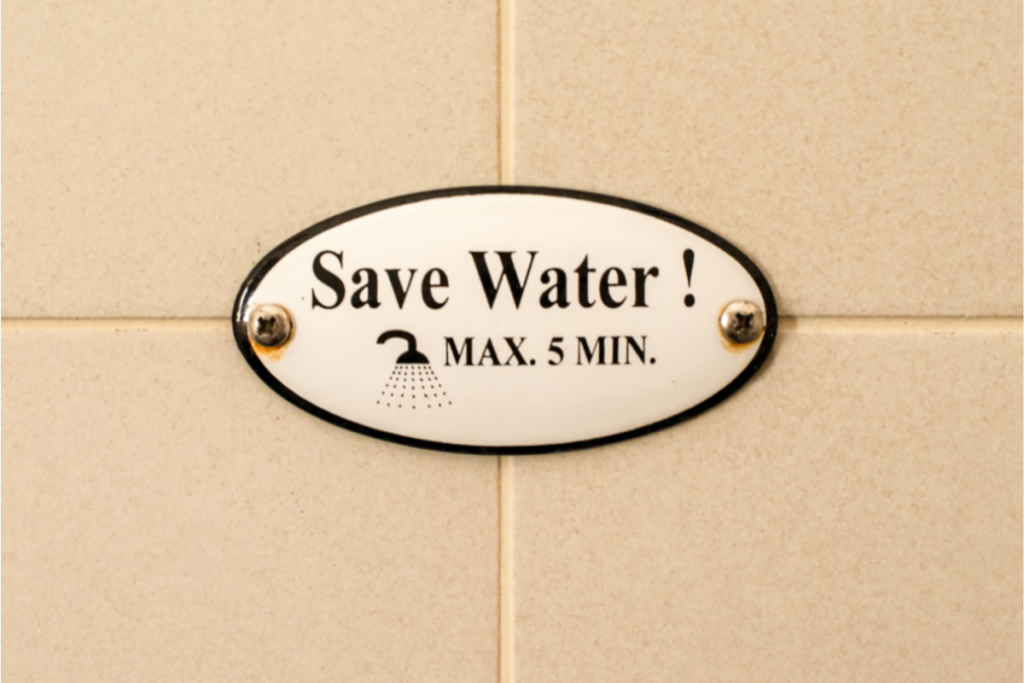 Ways to Conserve Water - Sign that says max 5 min Showers